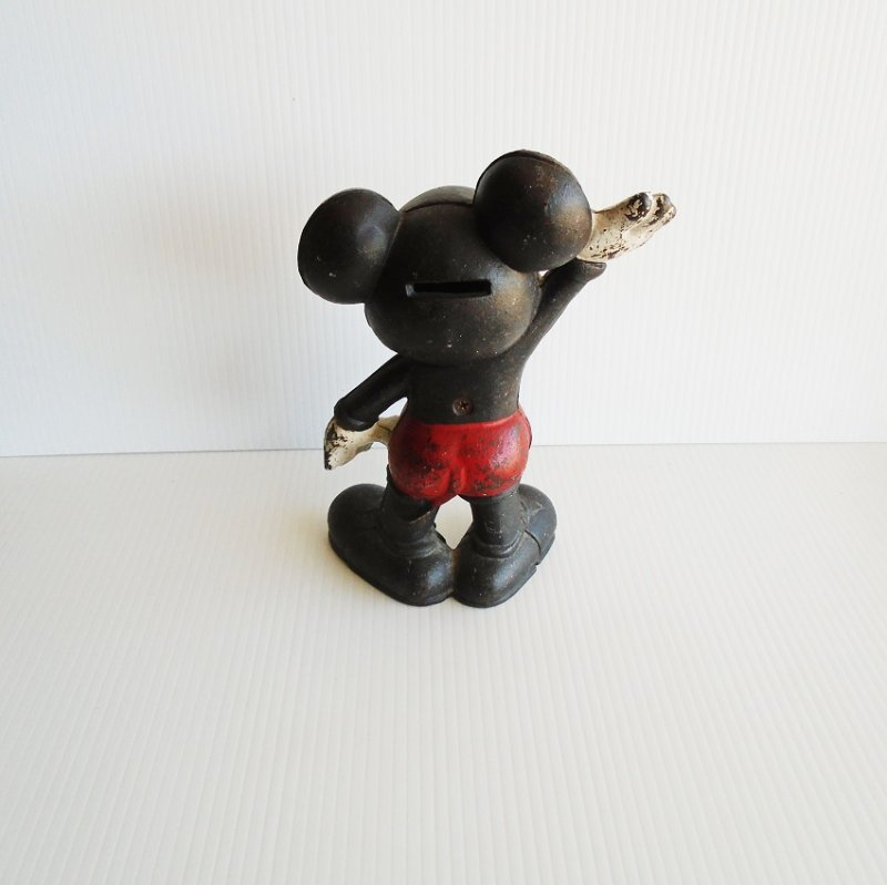 circa 1930s Mickey Mouse cast iron coin bank. This is the taller 9 inch version. Estate sale find.