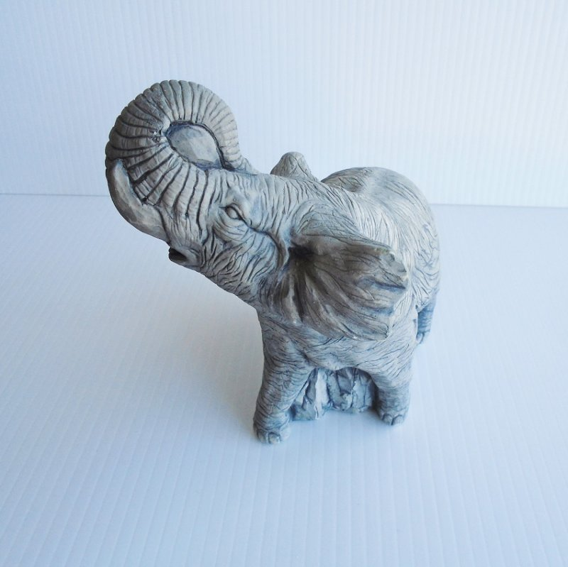 Elephant Sculpture made from Mt. St. Helen's volcanic ash in Washington State. Handmade. Unknown age.