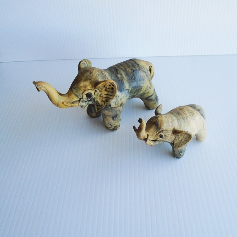 Mother and baby elephant sculptures possibly made from fired clay. Handmade. Unknown age.