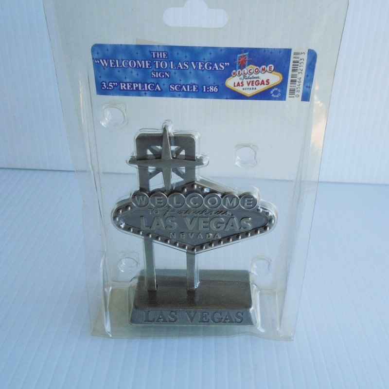 Mini 'Welcome to Las Vegas' iconic sign. Made of pewter with a silver finish. 3.5 inches tall. In original packaging, never used or displayed