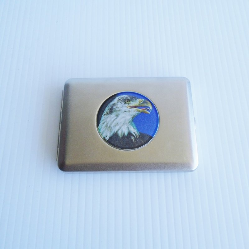 Cigarette case featuring an American Eagle. Holds 20 cigarettes. New, never used. NOS