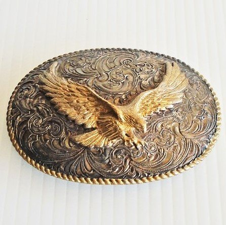 Eagle in flight belt buckle from Crumrine of Reno Nevada. Looks to be never used. Heavy silver plate. Estimated to be 1980s.