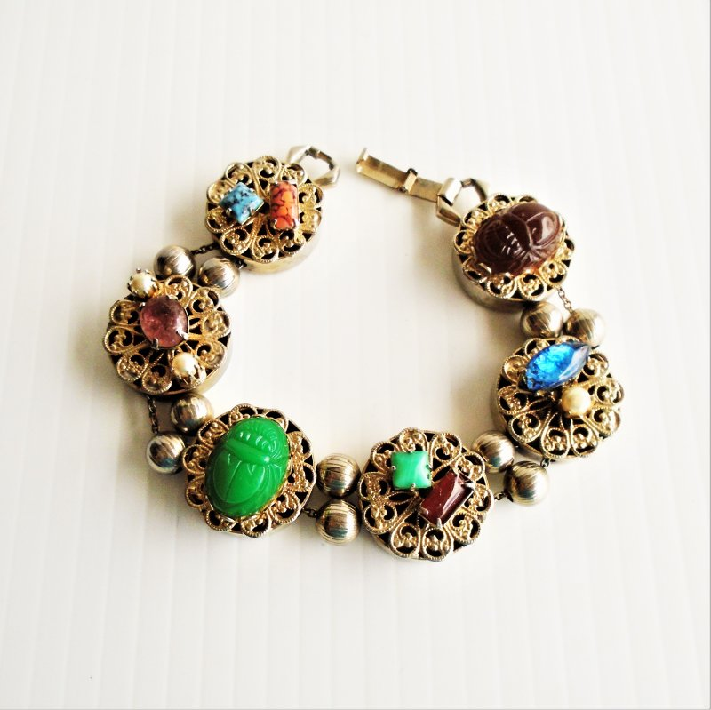 Unusual bracelet, kitschy and unique. Metal and 'gemstones'. 8 inch.
