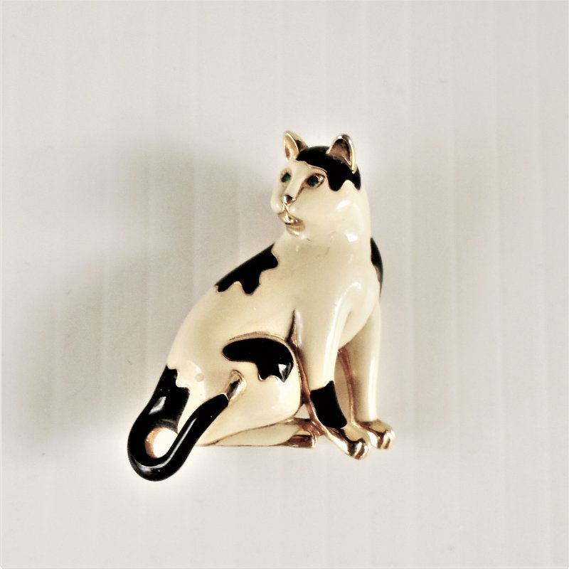 Cat or kitten brooch lapel pin. Black and white, enamel. 1.5 inch tall. Marked 'CT' on back. Estate find, unknown age.
