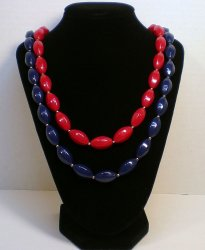 '.Red and Navy bead necklaces.'