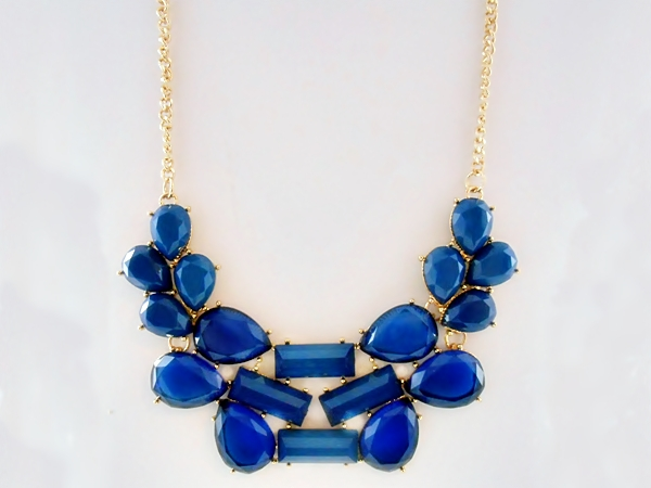 Blue abstract multi-shape stone and golden chain bib necklace with matching blue and gold earrings