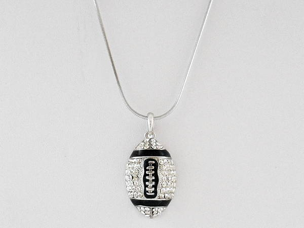Crystal studded rhinestone football pendant necklace on silver chain.
