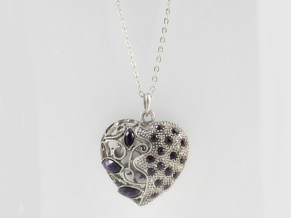Heart necklace antiqued silver filigree with purple faceted stones and purple rhinestone accents.