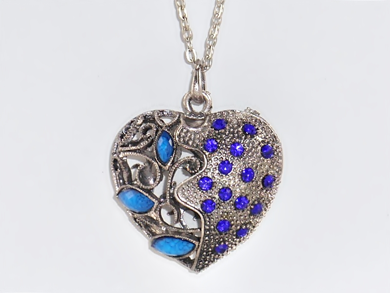 Heart necklace in antiqued silver filigree with blue faceted stones and blue rhinestone accents.