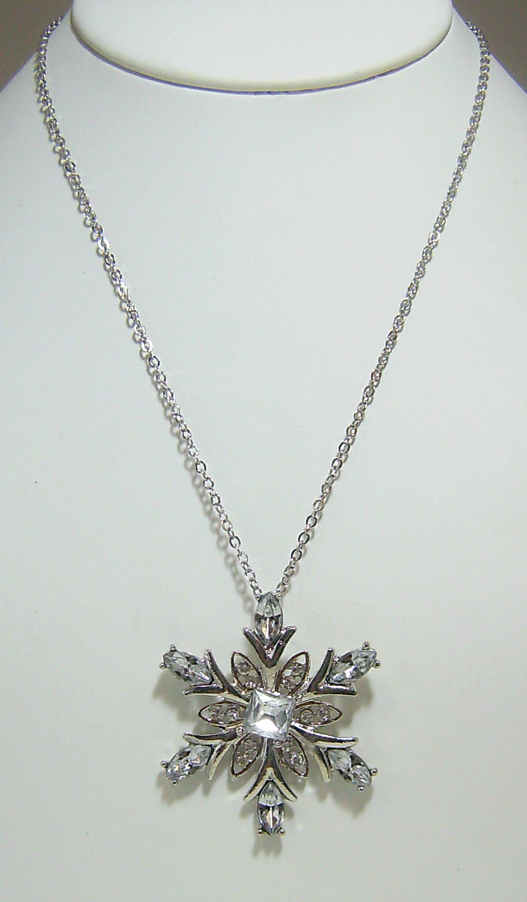 Silver snowflake rhinestone necklace with matching silver snowflake earrings.