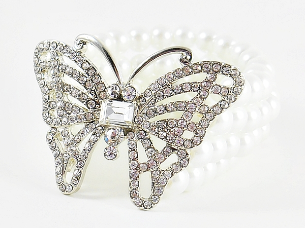 Rhinestone and silver butterfly on 4 line pearl stretch bracelet