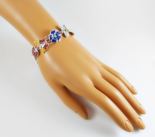 Flower garden link bracelet with butterfly, daisy, ladybug, bumble bee and other colorful Spring links with magnetic closure