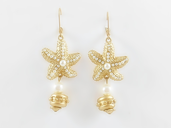 Matte gold and pearl dangle starfish earrings.