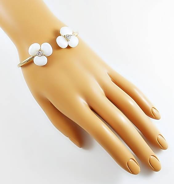 Pearly white shell stone flower mini cuff gold bracelet for a delicate, yet dramatic look. Each flower is accented in the center with a sparkly rhinestone for bling.