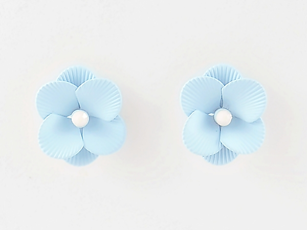 Feminine and detailed sky blue epoxy metal flower post earrings with tiny white center.