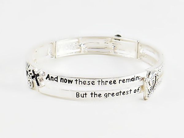 Bible verse Christian silver stretch bracelet with 1 Corinthians 13:13 features black lettering and accents including a heart, anchor and cross along with heart cutouts.