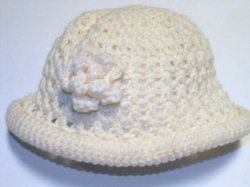 Crocheted Girls Hat Rolled Brim Crocheted Flower Handcrafted Cream Color