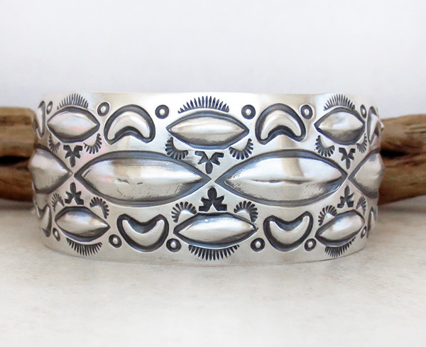 Image 1 of    Large Stamped Sterling Silver Repousse Bracelet Native American Made - 4329rb