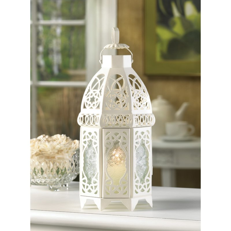 Lacy curves and cutouts combine for a truly enchanting design for this candle lantern!