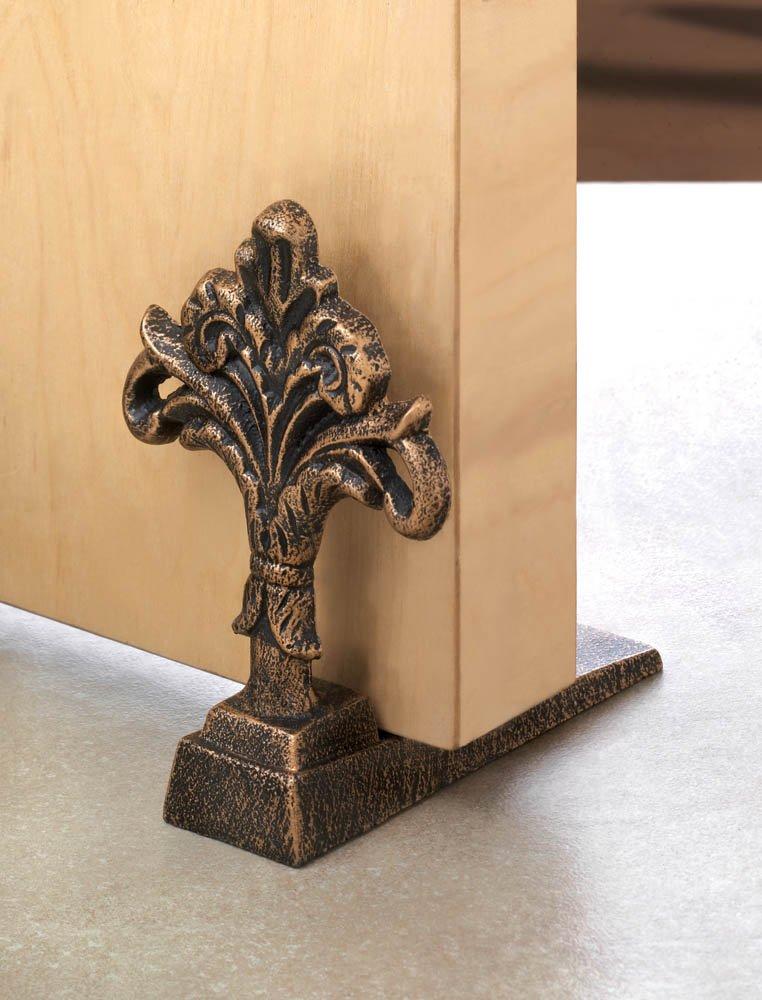 Image 0 of Fleur De Lis Cast Iron Decorative Door Stopper