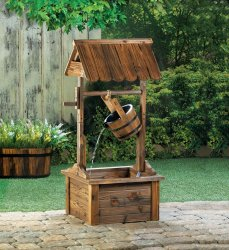 Wooden Roofed Wishing Well Garden Fountain Waster Flows From Metal Banded Bucket