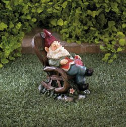 Garden Gnome Napping in Rocking Chair w/ Solar Red Bird on Lap Figurine