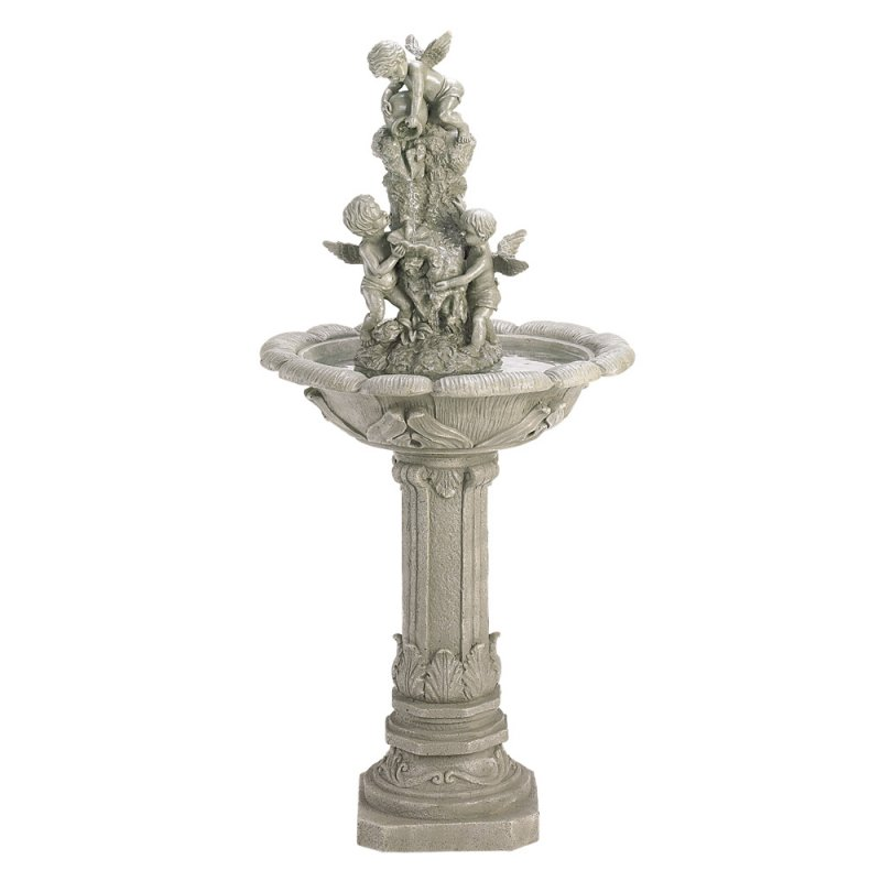 Playful cherubs send a cascade of water down the center of this classically designed fountain.