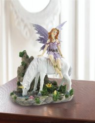 Lavender Dressed Fairy Sitting on White Unicorn Figurine