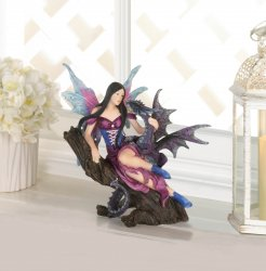 Fairy Sitting on Tree Trunk Holding Dragon Figurine