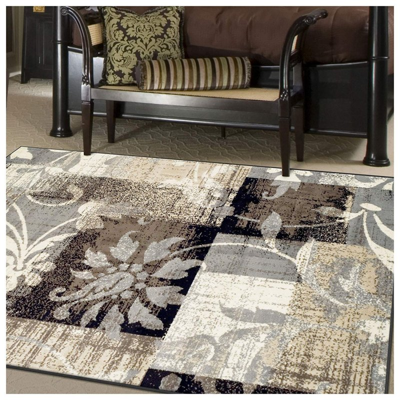 Neutral earthy tones are enhanced by a floral pattern with subtle geometric touches and a distressed finish. Pulling from both modern and traditional design, this area rug will transform any space in