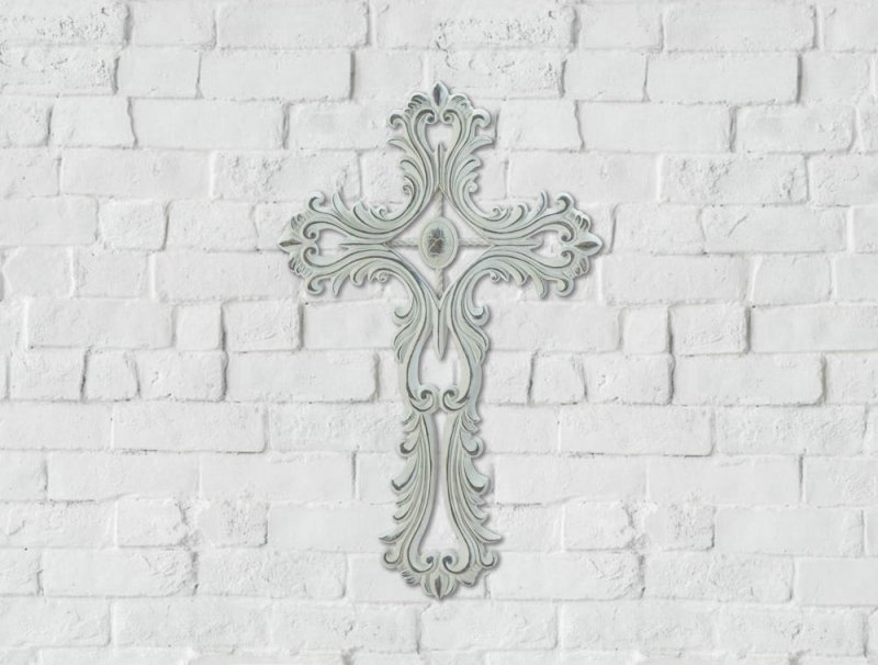 Open scrollwork allows wall color to show through to make an eye-catching decoration for your home. Hook on back for easy hanging.