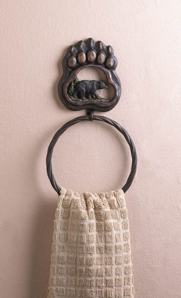 A large bear paw ornament at the top features a wooded scene and a majestic black bear on the move. Below is a circular rope of iron that's the perfect perch for a hand towel.