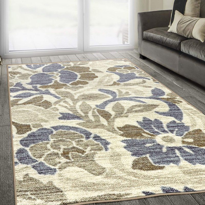 This gorgeous rug featuring flora and blooms in subdued colors of blue, beige, and taupe, artistically laid over a plush ivory base; finely screen-printed to give a woven effect; Non-Slip Foldable foa