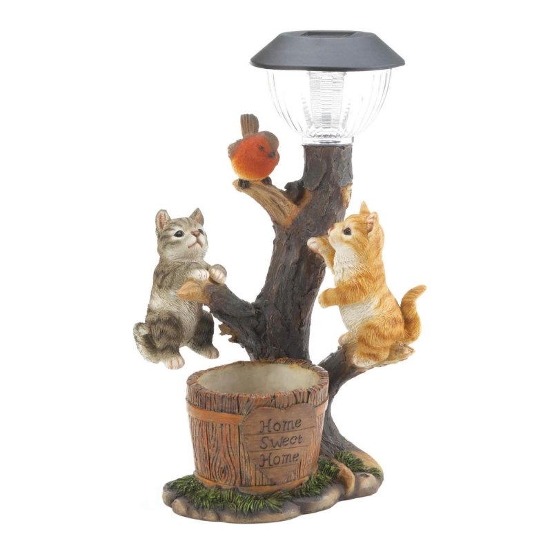 Imagine looking out your kitchen window and see this whimsical statue of two kittens playing on a branch trying to get a to a bird.