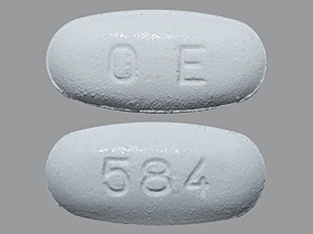O E, 584 tablet , white , oval oblong Debossed