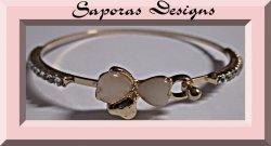 Gold Tone Bangle Bracelet With Bow & Heart Design White Beads & Clear Crystals