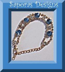 Gold Tone Bracelet With Blue & Clear Crystals