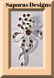Silver Tone Bow Design Brooch With Brown Crystals