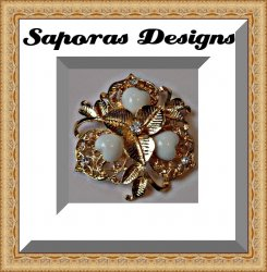 Gold Tone Flower Design Brooch With White Heart Design Beads