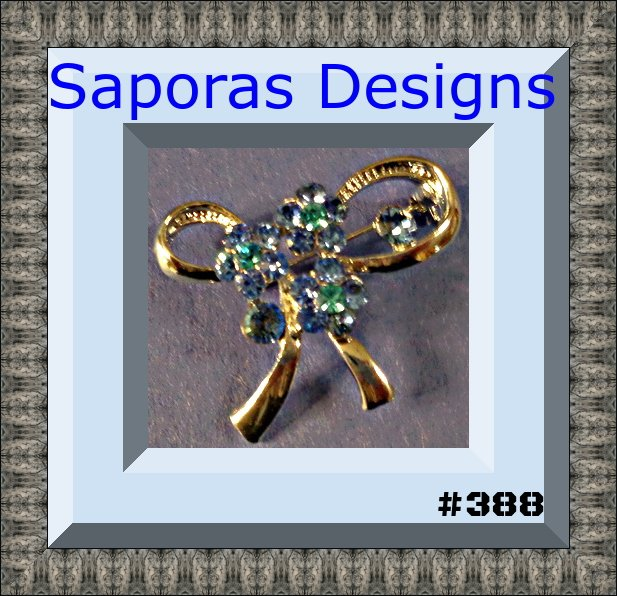 Image 0 of Silver Tone Bow Design Brooch With Blue Crystals