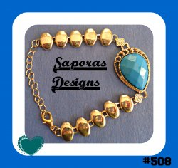 Gold Tone Bracelet With Blue Bead Egyptian Design