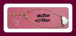 Gold Tone Bracelet With White Heart Design
