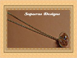Gold Tone Glass Ball Design Necklace With Orange Stars