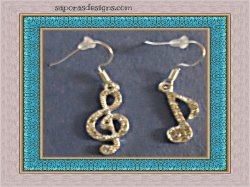 Silver Tone Music Note Design Dangle Earrings With Clear Crystals