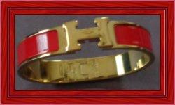 Gold Tone & Red Herme's H Clic Bracelet
