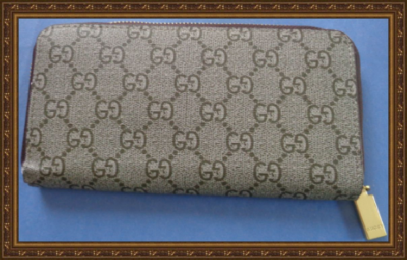 Image 1 of Brown Long Zippy Leather Wallet Classy Luxury With Snake Design Gold Tone Finish