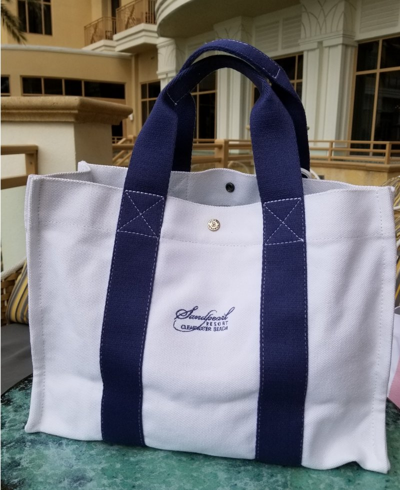 Canvas tote with blue handle and embroidered Resort logo