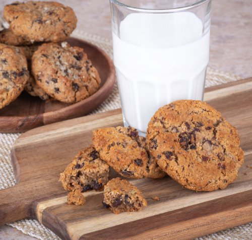 Freshly baked chocolate chip cookies and milk