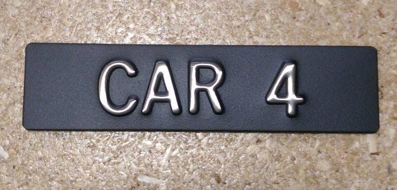 Image 0 of CAR14 Elevator Identification Plate 1 x 4 Black Background/Stainless Character