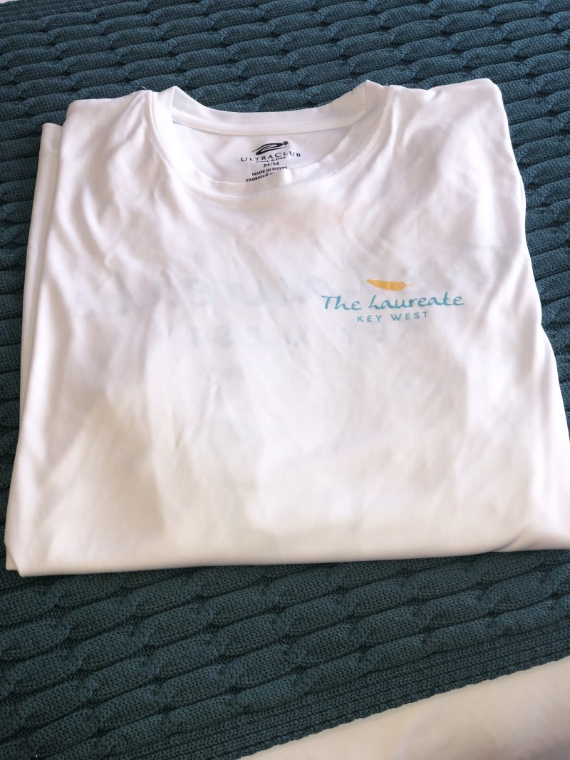 White fishing shirt with hotel Logo